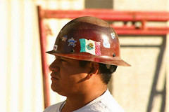 football--equipment and supplies(0.0), cap(0.0), helmet(1.0), personal protective equipment(1.0), clothing(1.0), hat(1.0), hard hat(1.0), person(1.0), headgear(1.0),
