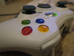 xbox 360(0.0), game controller(1.0), electronic device(1.0), joystick(1.0), gadget(1.0),