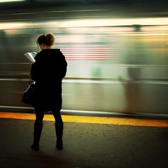 Woman standing on a subway platform
