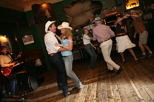 Countrywestern dancing at a cowboythemed wedding