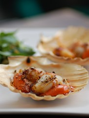 scallops on the half shell with paprika oil & a mint & green olive salad