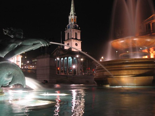 Trafalgar Square by night.
