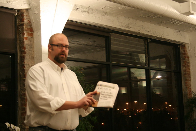 Alex Steffen Holding a Copy of the Globe & Mail