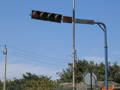light fixture(0.0), transport(0.0), mast(0.0), street light(0.0), construction equipment(0.0), advertising(0.0), signage(1.0), vehicle(1.0), signaling device(1.0), overhead power line(1.0), lighting(1.0), traffic light(1.0),