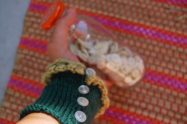 Green wrist warmers with buttons