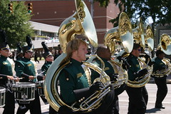 tuba(0.0), festival(1.0), sousaphone(1.0), marching band(1.0), musician(1.0), parade(1.0), musical ensemble(1.0), musical instrument(1.0), marching(1.0), brass instrument(1.0),