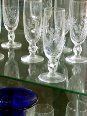 champagne(0.0), wine glass(0.0), glass bottle(0.0), wine(0.0), bottle(0.0), vase(0.0), crystal(0.0), drinkware(1.0), stemware(1.0), cobalt blue(1.0), tableware(1.0), highball glass(1.0), glass(1.0), champagne stemware(1.0),