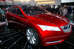 automobile(1.0), automotive exterior(1.0), exhibition(1.0), executive car(1.0), wheel(1.0), vehicle(1.0), automotive design(1.0), auto show(1.0), mid-size car(1.0), honda(1.0), sedan(1.0), land vehicle(1.0), luxury vehicle(1.0), sports car(1.0), acura(1.0),
