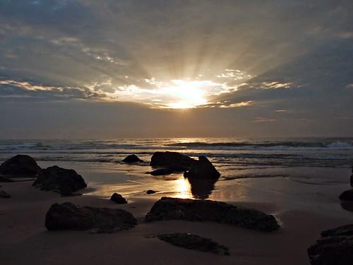 ocean reflection beach silhouette sunrise geotagged sand rocks waves australia sunray portmacquarie lighthousebeach fujifilms6500fd geo:lat=31480172 geo:lon=152929001