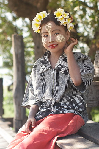 Myanmar girl with traditional make-up thanaka