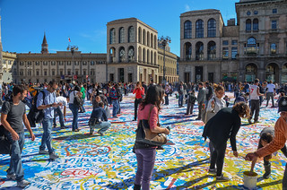 Painting the floor on Piazza del Duomo in Milan, Italy
