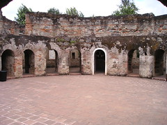 abbey(0.0), amphitheatre(0.0), ancient roman architecture(0.0), building(0.0), monastery(0.0), temple(0.0), palace(0.0), estate(0.0), place of worship(0.0), hacienda(0.0), arch(1.0), ancient history(1.0), historic site(1.0), ruins(1.0), fortification(1.0), archaeological site(1.0),