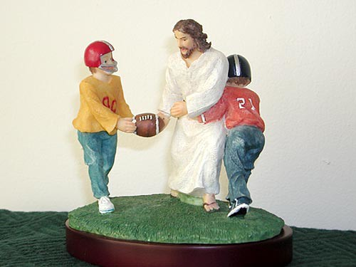 Jesus playing football / tackyjulie, via Flickr