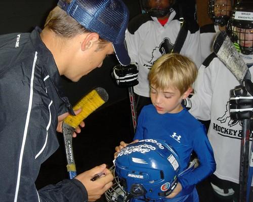 Dusty gets NHL player Zach Parise's autograph
