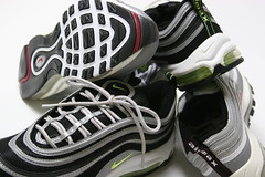 ball(0.0), sneakers(0.0), player(0.0), athlete(0.0), cross training shoe(1.0), tennis shoe(1.0), outdoor shoe(1.0), bicycle shoe(1.0), running shoe(1.0), footwear(1.0), white(1.0), nike free(1.0), shoe(1.0), athletic shoe(1.0), black(1.0),