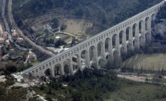 ancient history(0.0), suspension bridge(0.0), controlled-access highway(0.0), devil's bridge(1.0), highway(1.0), aqueduct(1.0), transport(1.0), landmark(1.0), overpass(1.0), aerial photography(1.0), arch bridge(1.0), viaduct(1.0), infrastructure(1.0), bridge(1.0),