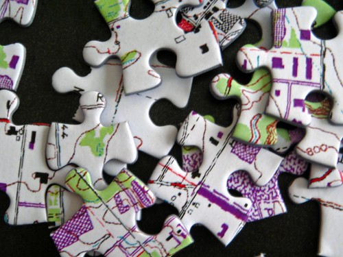 An image of puzzle pieces in a heap