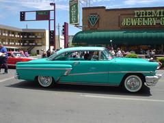 full-size car(0.0), convertible(0.0), automobile(1.0), automotive exterior(1.0), vehicle(1.0), mercury montclair(1.0), antique car(1.0), sedan(1.0), land vehicle(1.0), luxury vehicle(1.0),