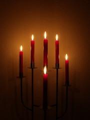 light fixture(0.0), hanukkah(0.0), decor(1.0), candle(1.0), red(1.0), light(1.0), darkness(1.0), lighting(1.0),