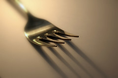 hand(0.0), fork(1.0), close-up(1.0), cutlery(1.0),
