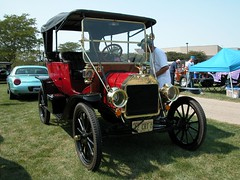 ford model a(0.0), automobile(1.0), wheel(1.0), vehicle(1.0), ford model tt(1.0), touring car(1.0), ford(1.0), antique car(1.0), classic car(1.0), vintage car(1.0), land vehicle(1.0), luxury vehicle(1.0), ford model t(1.0), motor vehicle(1.0),