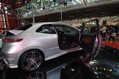 family car(0.0), sports sedan(0.0), honda(0.0), sedan(0.0), automobile(1.0), automotive exterior(1.0), exhibition(1.0), wheel(1.0), vehicle(1.0), automotive design(1.0), rim(1.0), auto show(1.0), honda civic type r(1.0), land vehicle(1.0), supercar(1.0), sports car(1.0),