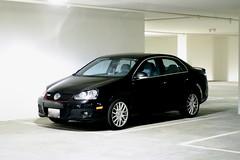 city car(0.0), volkswagen jetta(0.0), automobile(1.0), automotive exterior(1.0), executive car(1.0), family car(1.0), wheel(1.0), volkswagen(1.0), vehicle(1.0), automotive design(1.0), volkswagen gli(1.0), volkswagen gti(1.0), full-size car(1.0), mid-size car(1.0), subcompact car(1.0), compact car(1.0), bumper(1.0), sedan(1.0), land vehicle(1.0),