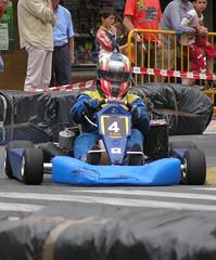 formula racing(0.0), dirt track racing(0.0), formula one(0.0), formula one car(0.0), race car(1.0), auto racing(1.0), automobile(1.0), go-kart(1.0), kart racing(1.0), racing(1.0), vehicle(1.0), sports(1.0), race(1.0), open-wheel car(1.0), motorsport(1.0), race track(1.0),