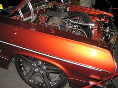 bumper(0.0), automobile(1.0), automotive exterior(1.0), wheel(1.0), vehicle(1.0), engine(1.0), antique car(1.0), land vehicle(1.0), luxury vehicle(1.0), muscle car(1.0), motor vehicle(1.0),