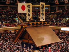 The signs above the Shinto shrine roof thank the audience for filling the stadium.