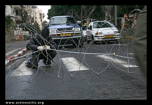 Direct Action against the wall and restrictions of movements in Palestine, Anarchists Blocking Rotchield street in Tel Aviv, Israel, 03/02/07