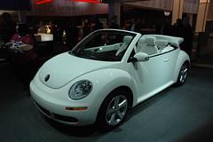 sedan(0.0), automobile(1.0), volkswagen beetle(1.0), automotive exterior(1.0), wheel(1.0), volkswagen(1.0), vehicle(1.0), automotive design(1.0), volkswagen new beetle(1.0), auto show(1.0), subcompact car(1.0), city car(1.0), land vehicle(1.0), luxury vehicle(1.0),