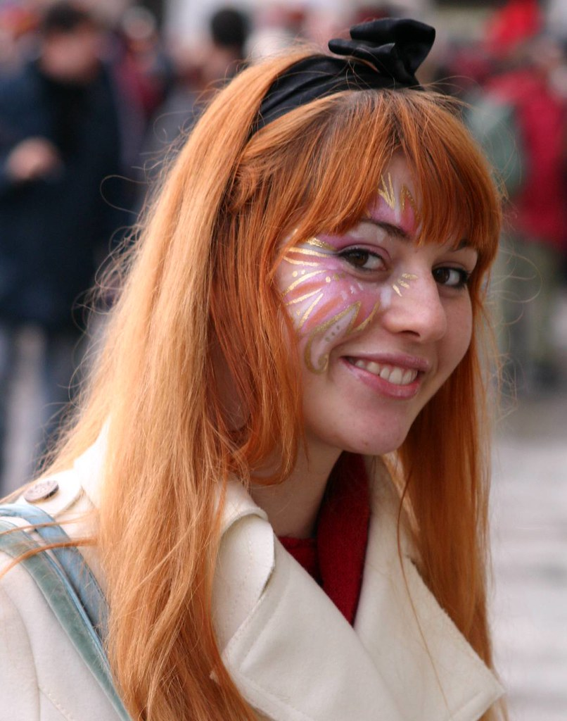 Face painting on a redhead with a great smile and eyes, Carnivale 2007,
