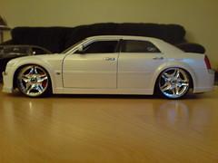 model car(0.0), automobile(1.0), automotive exterior(1.0), wheel(1.0), vehicle(1.0), automotive design(1.0), rim(1.0), chrysler 300(1.0), chrysler(1.0), bumper(1.0), sedan(1.0), land vehicle(1.0), luxury vehicle(1.0),