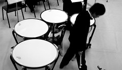 bass drum(0.0), drummer(0.0), electronic drum(0.0), drums(0.0), electronic instrument(0.0), tom-tom drum(1.0), percussion(1.0), musician(1.0), white(1.0), monochrome photography(1.0), drum(1.0), timbales(1.0), monochrome(1.0), black-and-white(1.0), timpani(1.0), skin-head percussion instrument(1.0),