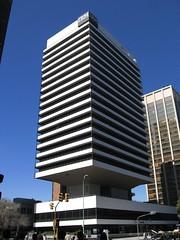 residential area(0.0), plaza(0.0), tower block(1.0), metropolitan area(1.0), building(1.0), skyscraper(1.0), commercial building(1.0), landmark(1.0), metropolis(1.0), architecture(1.0), headquarters(1.0), brutalist architecture(1.0), condominium(1.0), facade(1.0), downtown(1.0), tower(1.0),