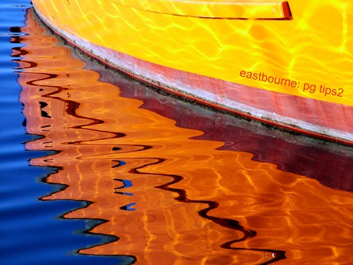 light sea england orange sunlight abstract color colour detail reflection art water colors yellow marina reflections boats sussex mirror coast seaside colours dancing harbour ripple 2006 calm resort views eastbourne 23 rays 500 favourite sprites eastsussex primary waterreflections tangerinedream reflectionsinwater wetreflections stupenda riples colorphotoaward eastbournemarina worldbetweenworlds
