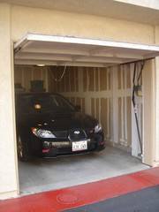 automobile, automotive exterior, garage, vehicle, bumper, car park, parking,