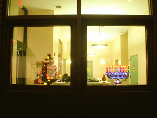 christmas tree and menorah in window