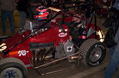 go-kart(0.0), touring car(0.0), antique car(0.0), vintage car(0.0), race car(1.0), auto racing(1.0), automobile(1.0), racing(1.0), vehicle(1.0), sports(1.0), race(1.0), dirt track racing(1.0), motorsport(1.0), sprint car racing(1.0), engine(1.0), race track(1.0), land vehicle(1.0),