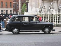van(0.0), sedan(0.0), automobile(1.0), family car(1.0), vehicle(1.0), austin fx4(1.0), compact car(1.0), antique car(1.0), classic car(1.0), vintage car(1.0), land vehicle(1.0), luxury vehicle(1.0),