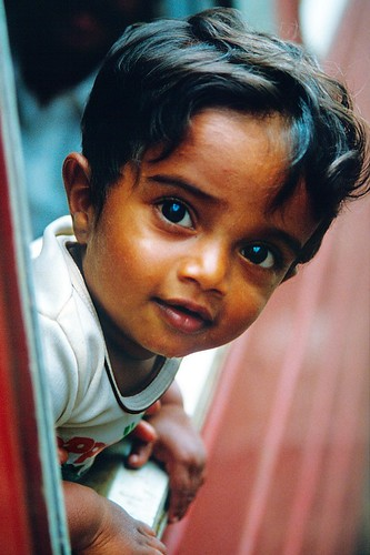 Curious boy on the train from Kandy to Colombo, Sri Lanka
