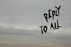 image of a gray sky with REPLY TO ALL in a funky script written on top of the picture
