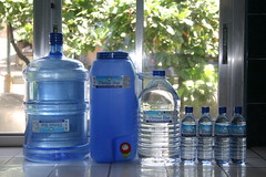 drinkware(0.0), drink(0.0), water(1.0), distilled beverage(1.0), bottle(1.0), bottled water(1.0), blue(1.0), drinking water(1.0),