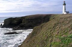 sea, ocean, loch, lighthouse, headland, bay, body of water, wave, shore, terrain, cove, coast, tower, rock, cliff,