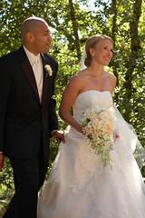 groom(0.0), bridesmaid(0.0), bride(1.0), bridal clothing(1.0), groom(1.0), gown(1.0), wedding(1.0), man(1.0), woman(1.0), female(1.0), wedding dress(1.0), person(1.0), dress(1.0), ceremony(1.0),