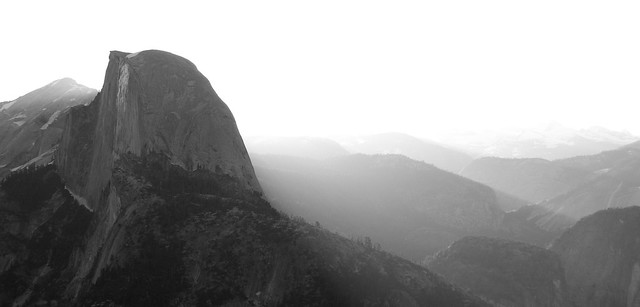 Sun rising behind Half Dome by Loyd Schutte