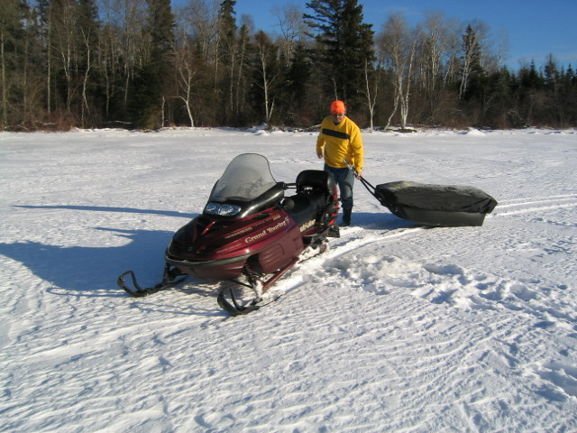 Dragging the portable ice fishing shack flickr photo for Ice fishing apps