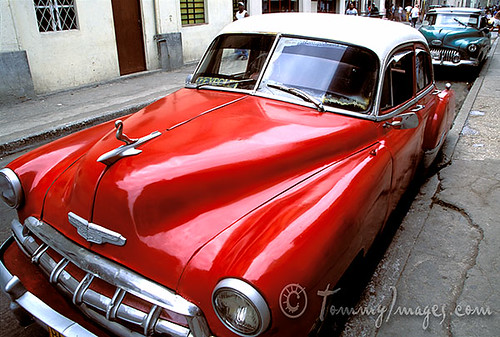 A red classic car sits in Havana