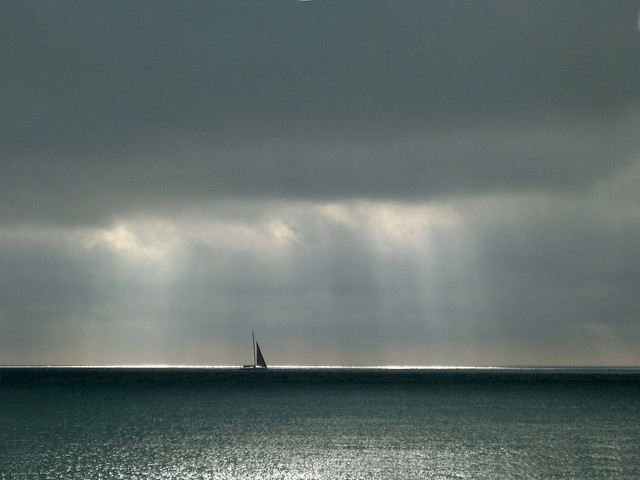 Storm approaching.  Sailboat had better head to shore!